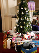 City Mission donations under Christmas tree