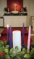 Advent wreath with first candle lit