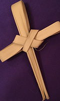 palm leaf folded into a cross, for Palm Sunday