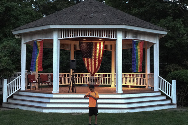 Gay Pride flags were added to Milton's Town Gazebo during the Orlando Massacre Vigil