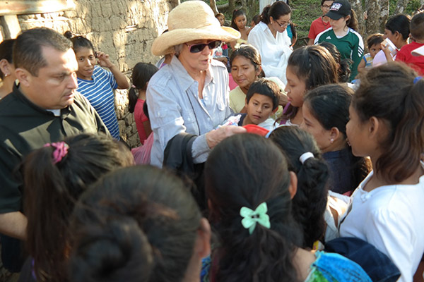 Father Ulysses and Becky handing out toys and clothes in El Ocote outside Matagalpa, Nicaragua